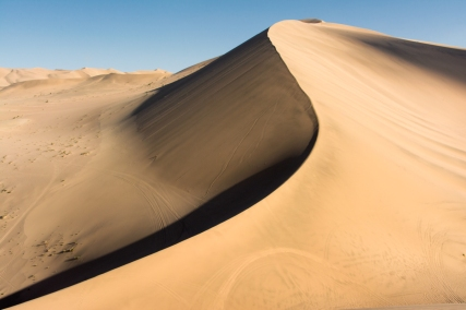 The sand makes a soft moaning sound when it shifts, ancients believed it to be the trapped souls of those that perished in the dunes.